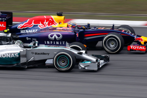 Shanghai International Circuit, Shanghai, China. Sunday 20 April 2014. Nico Rosberg, Mercedes W05, passes Sebastian Vettel, Red Bull Racing RB10 Renault. World Copyright: Glenn Dunbar/LAT Photographic. ref: Digital Image _89P2776