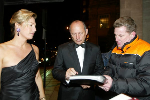 2003 AUTOSPORT AWARDS, The Grosvenor, London. 7th December 2003.Ron Dennis stops to sign an autograph.Photo: Peter Spinney/LAT PhotographicRef: Digital Image only