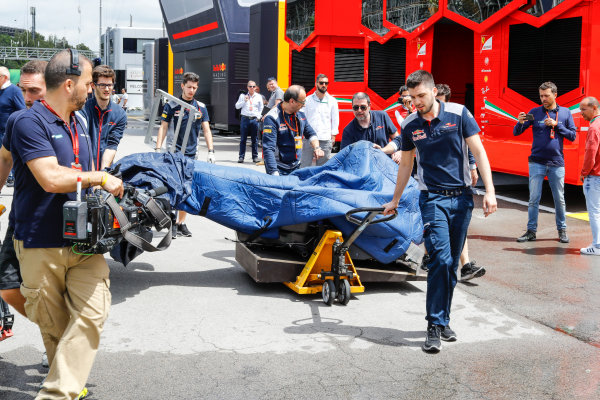 Circuit de Catalunya, Barcelona, Spain. Thursday 11 May 2017. Toro Rosso team members are filmed wheeling a monocoque under wraps through the paddock. Sky pundits Martin Brundle and David Croft look on. World Copyright: Steven Tee/LAT Images ref: Digital Image _O3I1675