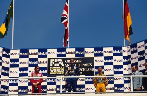 L to R; Ayrton Senna, Nigel Mansell and Michael Schumacher on the podium. German Grand Prix, Hockenheim, 26 July 1992