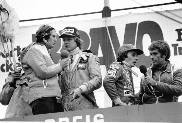 1978 Austrian Grand Prix. Osterreichring, Zeltweg, Austria. 11-13 August 1978. Ronnie Peterson, (Lotus 78 Ford) 1st position and Gilles Villeneuve, (Ferrari 312T3) 3rd position, podium. World Copyright - LAT Photographic. ref: 11655/29.