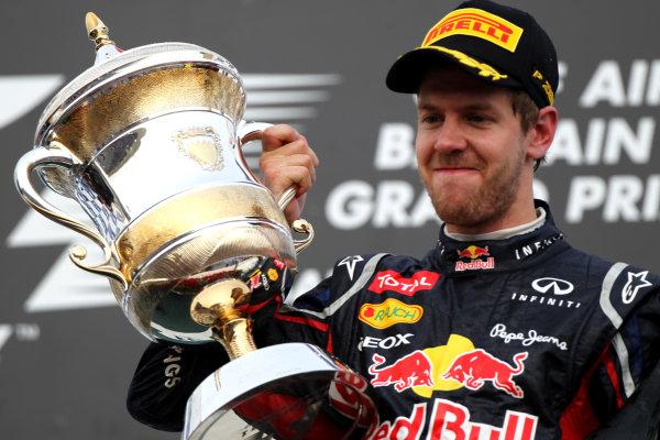 Bahrain International Circuit, Sakhir, Bahrain22nd April 2012Sebastian Vettel, Red Bull Racing, 1st position, with his trophy.World Copyright: Andy Hone/LAT Photographicref: Digital Image HONY8746