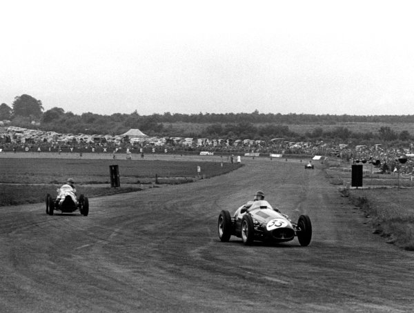 Silverstone, Great Britain. 17th July 1954.Onfore Marimon, Maserati 250F, 3rd position, passes Leslie Marr, Connaught A-Lea Francis, 13th position, action.World Copyright: LAT PhotographicRef: 5393/C2-21
