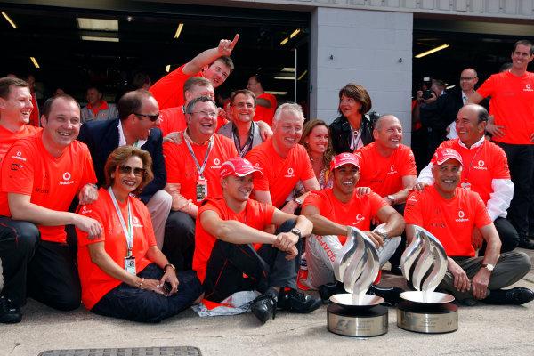 Silverstone, Northamptonshire, UK.6th July 2008.Lewis Hamilton, McLaren MP4-23 Mercedes, 1st position, and Heikki Kovalainen, McLaren MP4-23 Mercedes, 5th position, with the McLaren team after the race. Portrait. World Copyright: Glenn Dunbar/LAT Photographic.ref: Digital Image _O9T7469