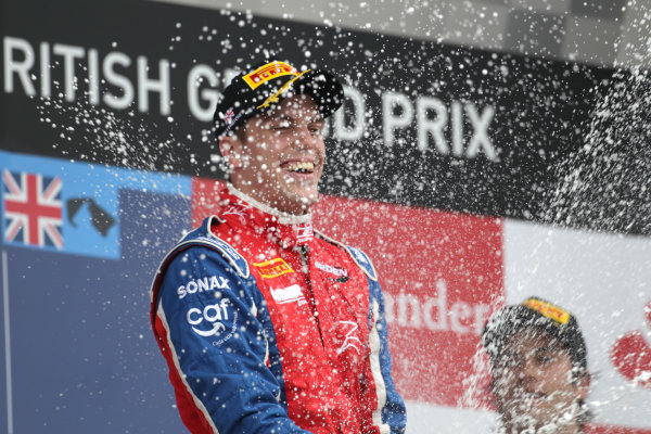 Silverstone, Northamptonshire, England. 8th July 2012. Sunday Race. Luiz Razia (BRA, Arden International) celebrates his victory on the podium.Photo: Photo: Jakob Ebrey/GP2 Media Service./GP2 Media Service. Ref: Digital Image JE2_7946.jpg