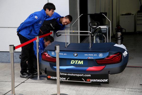 Japanese Team member looking on car parts of Alex Zanardi, BMW Team RBM BMW M4 DTM.