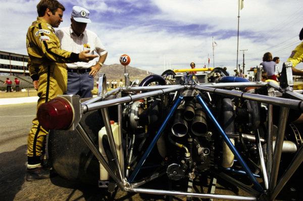 Mark Donohue in conversation beside his Penske Racing-entered Porsche 917/30 TC.