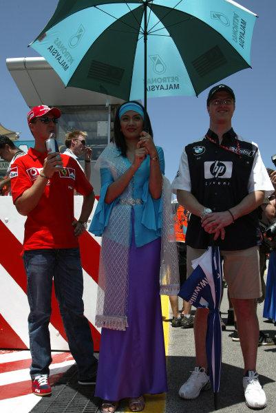 2003 Malaysian Grand Prix. Sepang, Kuala Lumpur, Malaysia.21-23 March 2003.Michael Schumacher (Ferrari) with brother Ralf Schumacher (Williams BMW).World Copyright - Steve Etherington/LAT Photographic ref: Digital Image Only