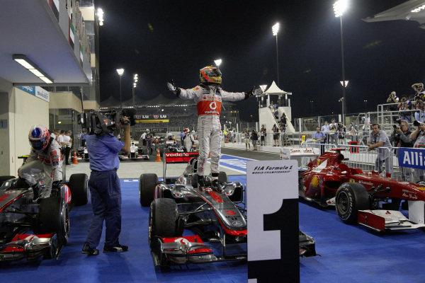 Lewis Hamilton celebrates on top of his McLaren MP4-26 Mercedes in Parc Ferme, alongside Jenson Button, McLaren MP4-26 Mercedes.