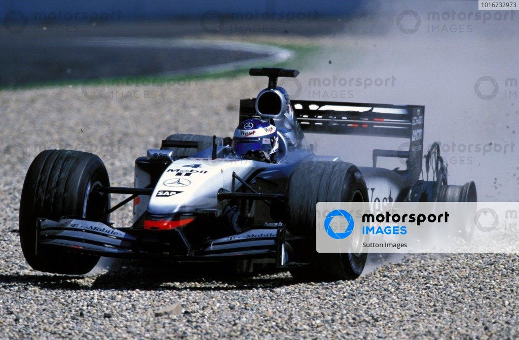 Kimi Raikkonen (FIN) McLaren Mercedes MP4/17 lost time when a tyre exploded. Formula One World Championship, Rd12, German Grand Prix, Hockenheim, Germany. 28 July 2002. BEST IMAGE
