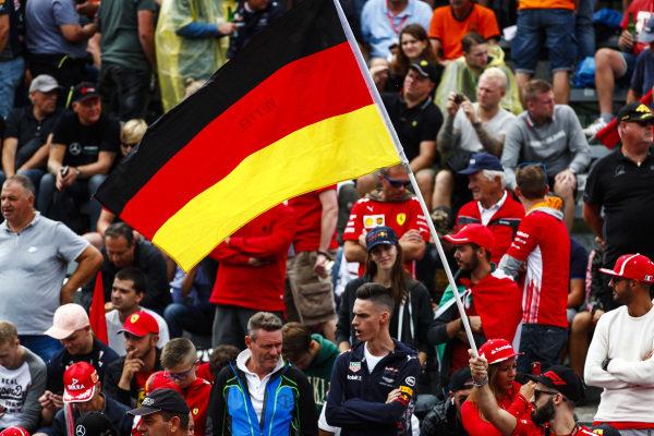 German flag flown by the tifosi for Sebastian Vettel, Ferrari.