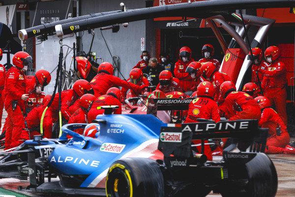 Charles Leclerc, Ferrari SF21, makes a stop as Esteban Ocon, Alpine A521, passes