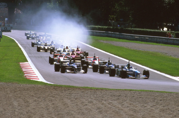 Monza, Italy.6-8 September 1996.Jean Alesi (Benetton B196 Renault) leads Damon Hill and Jacques Villeneuve (Williams FW18 Renault) into the Roggia Chicane at the start.Ref-96 ITA 09.World Copyright - LAT Photographic