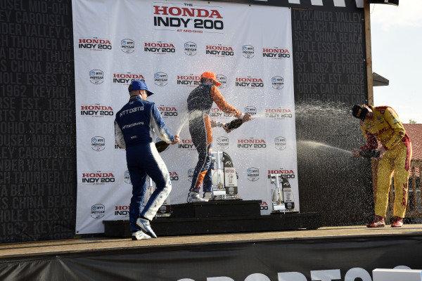 Felix Rosenqvist, Chip Ganassi Racing Honda, Scott Dixon, Chip Ganassi Racing Honda and Ryan Hunter-Reay, Andretti Autosport Honda spray champagne on the podium