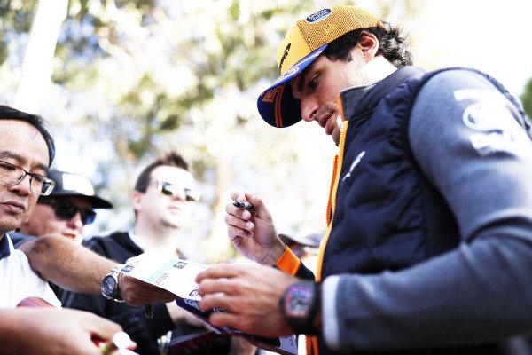 Carlos Sainz Jr, McLaren signs autographs for fans.