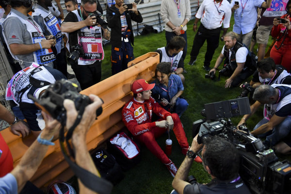Charles Leclerc, Ferrari speaks with the media on the grid