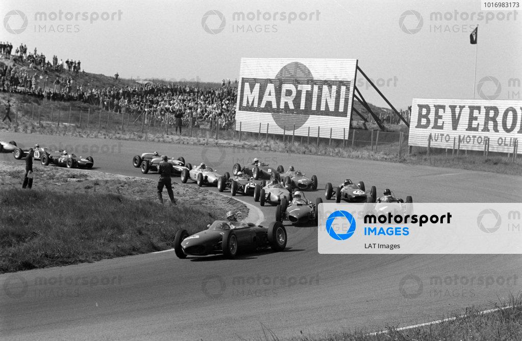 Wolfgang von Trips, Ferrari 156, Phil Hill, Ferrari 156, and Graham Hill, BRM P48/57 Climax, lead the field at the start.