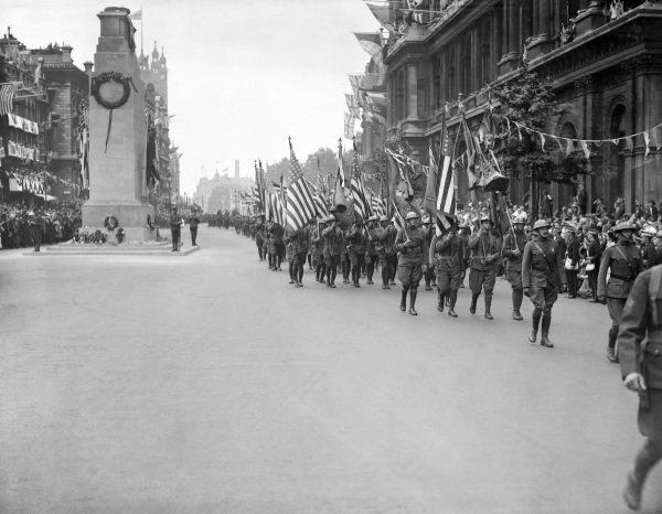 American soldiers parade past the Cenotaph in Whitehall, London, during Peace Day celebrations.