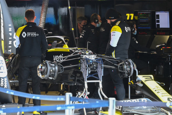 Renault mechanics with Daniel Ricciardo's Renault R.S.20 in the garage