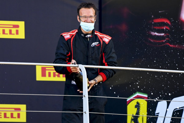 The ART podium representative pops his Champagne