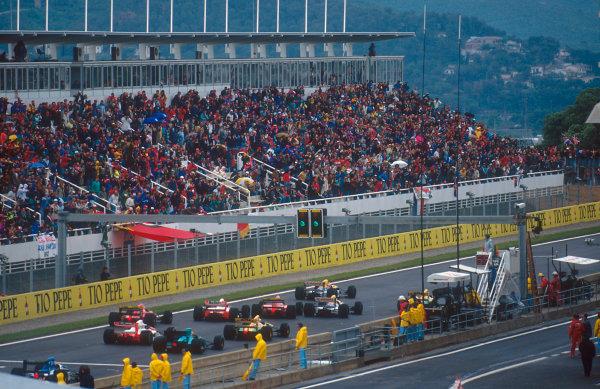 1992 Spanish Grand Prix.Catalunya, Barcelona, Spain.1-3 May 1992.Nigel Mansell leads teammate Riccardo Patrese (both Williams FW14B Renault's), Jean Alesi (Ferrari F92A), Ayrton Senna (McLaren MP4/7A), Michael Schumacher (Benetton 192 Ford), Ivan Capelli (Ferrari F92A), Gerhard Berger (McLaren MP4/7A), Karl Wendlinger (March CG911 Ilmor) and Erik Comas (Ligier JS37 Renault) at the start.Ref-92 ESP 07.World Copyright - LAT Photographic