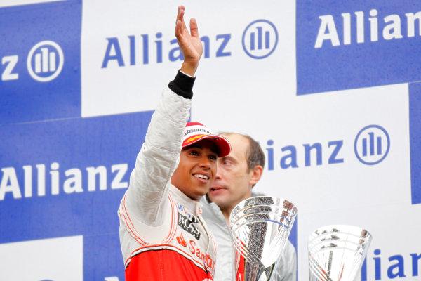 Spa-Francorchamps, Spa, Belgium 29th August 2010 Lewis Hamilton, McLaren MP4-25 Mercedes, 1st position, celebrates on the podium. Portrait. Podium.  World Copyright: Charles Coates/LAT Photographic ref: Digital Image _G7C0707