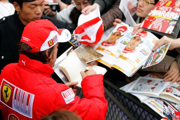Shanghai International Circuit, Shanghai, China15th April 2010Fernando Alonso, Ferrari F10, signs autographs for fans. Portrait. Atmosphere. World Copyright: Andrew Ferraro/LAT Photographicref: Digital Image _Q0C5324