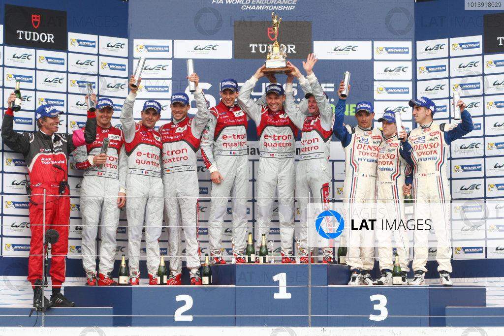 2013 FIA WEC Championship, Silverstone, Northamptonshire. 12th - 14th April 2013. Tom Kristensen / Loic Duval / Allan McNish Audi R18 e-tron quattro celebrate the win on the podium World Copyright: Ebrey / LAT Photographic.
