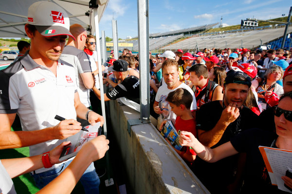 Hungaroring, Budapest, Hungary. Thursday 21 July 2016. Esteban Gutierrez, Haas F1 signs autographs for fans. World Copyright: Andrew Hone/LAT Photographic ref: Digital Image _ONZ0597