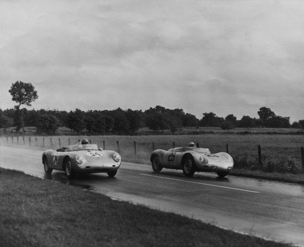 Le Mans, France. 21 - 22 June 1958.Jean Behra/Hans Herrmann (Porsche 718 RSK Spyder), 3rd position, passes Jean Kerguen/Franc (Porsche 550A RS), 10th position, action. World Copyright: LAT PhotographicRef: B/WPRINT.