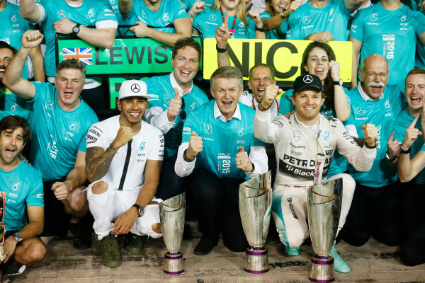 Yas Marina Circuit, Abu Dhabi, United Arab Emirates. Sunday 29 November 2015. Nico Rosberg, Mercedes AMG, 1st Position, Lewis Hamilton, Mercedes AMG, 2nd Position, and the Mercedes team celebrate victory. World Copyright: Alastair Staley/LAT Photographic. ref: Digital Image _R6T4401