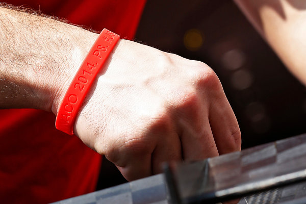 Monte Carlo, Monaco. Wednesday 20 May 2015. A Manor employee wears a commemorative wristaband for Jules Bianchi. World Copyright: Charles Coates/LAT Photographic. ref: Digital Image _J5R6169