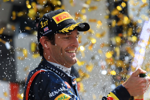 Race winner Mark Webber (AUS) Red Bull Racing celebrates on the podium. Formula One World Championship, Rd9, British Grand Prix, Race, Silverstone, England, Sunday 8 July 2012.   BEST IMAGE
