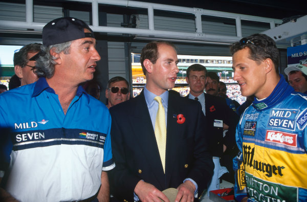Adelaide, Australia. 10-12 November 1995. Benetton Renault boss, Flavio Briatore talks with HRH Prince Edward and Michael Schumacher, portrait. Ref-95 AUS 59 World Copyright - LAT Photographic
