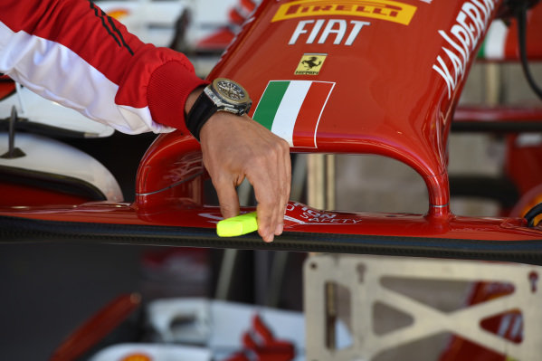 Marc Gene (ESP) Ferrari Test Driver pulls a cover off a sensor on the nose of the Ferrari F14 T whilst commentating for Sky Sports Italia. Formula One World Championship, Rd17, United States Grand Prix, Practice, Austin, Texas, USA, Friday 31 October 2014.