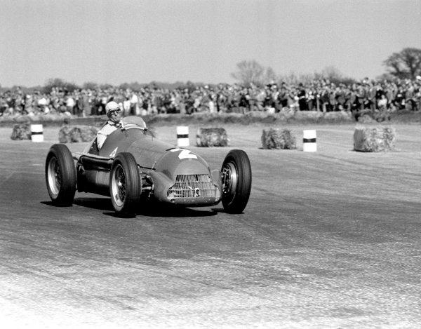 1950 British Grand Prix. Silverstone, Great Britain. 13th May 1950. Giuseppe Farina (Alfa Romeo 158), 1st position. World Copyright: LAT Photographic ref: 50/13/25A