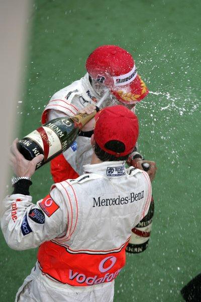 2007 Malaysian Grand Prix - Sunday RaceSepang, Kuala Lumpur. Malaysia.8th April 2007.Fernando Alonso, McLaren MP4-22 Mercedes, 1st  position, and team mate Lewis Hamilton, McLaren MP4-22 Mercedes, 2nd position, celebrate on the podium. Podiums. Portrait. World Copyright: Steven Tee/LAT Photographic.ref: Digital Image YY2Z7676A