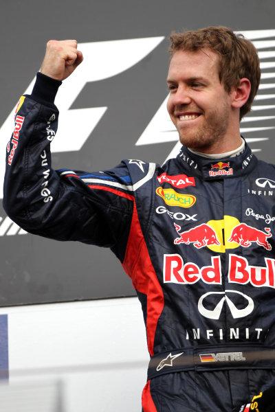 Bahrain International Circuit, Sakhir, Bahrain22nd April 2012Sebastian Vettel, Red Bull Racing, 1st position, celebrates on the podium.World Copyright: Andy Hone/LAT Photographicref: Digital Image HONY8616