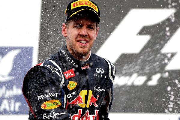 Bahrain International Circuit, Sakhir, Bahrain22nd April 2012Sebastian Vettel, Red Bull Racing, 1st position, sprays the Waard.World Copyright: Andy Hone/LAT Photographicref: Digital Image HONY8699