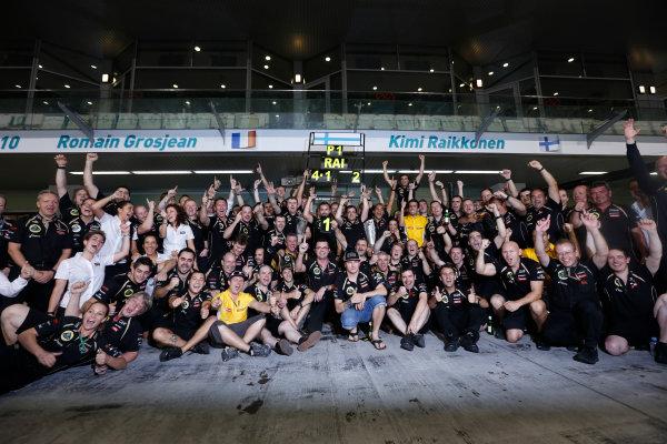 Yas Marina Circuit, Abu Dhabi, United Arab Emirates Sunday 4th November 2012. Kimi Raikkonen, Lotus GP, 1st position, and the Lotus team celbrate victory. World Copyright:Andrew Ferraro/  ref: Digital Image _79P4097