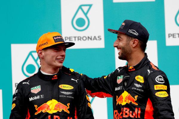 Sepang International Circuit, Sepang, Malaysia. Sunday 1 October 2017. Max Verstappen, Red Bull, 1st Position, and Daniel Ricciardo, Red Bull Racing, 3rd Position, on the podium. World Copyright: Glenn Dunbar/LAT Images  ref: Digital Image _X4I4007