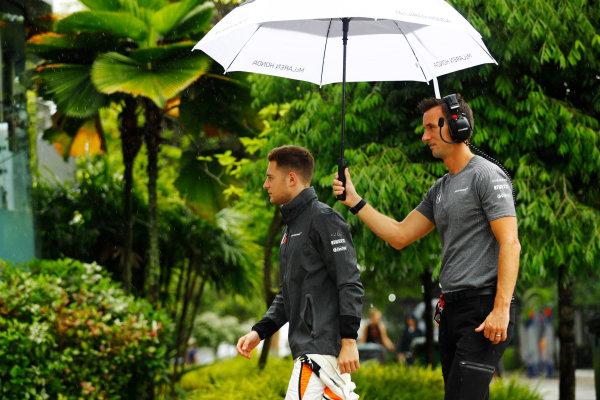 Sepang International Circuit, Sepang, Malaysia. Friday 29 September 2017. Stoffel Vandoorne, McLaren, walks under an umbrella in the paddock. World Copyright: Steven Tee/LAT Images  ref: Digital Image _R3I2087