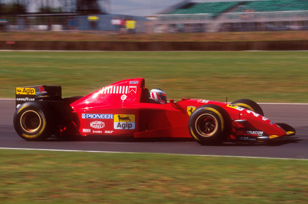 Silverstone, England.14-16 July 1995.Gerhard Berger (Ferrari 41T2). He exited the race when after his pitstop the front left wheel had not been fitted properly, so he had to park up on the grass.Ref-95 GB 33.World Copyright - LAT Photographic