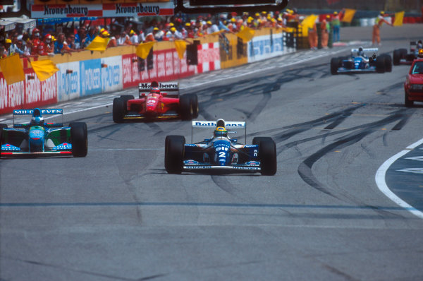 Imola, Italy.29/4-1/5 1994.Ayrton Senna (Williams FW16 Renault) leads the rest of the field behind the safety car which was brought out after the Lehto/Lamy startline shunt.Ref-94 SM 24.World Copyright - LAT Photographic