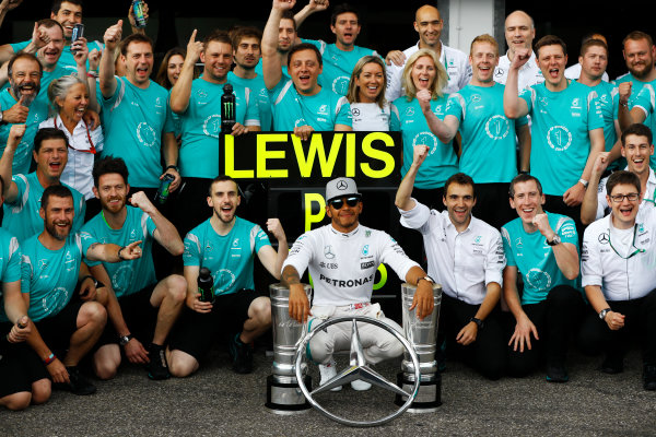 Hockenheim, Germany. Sunday 31 July 2016. Lewis Hamilton, Mercedes AMG, 1st Position, with the days trophy haul, celebrates with his team. World Copyright: Andrew Hone/LAT Photographic ref: Digital Image _ONY1498