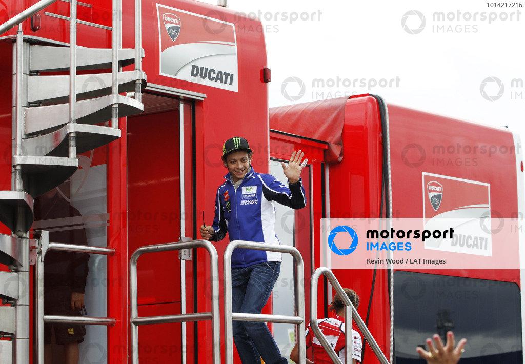 2014 MotoGP Championship  British Grand Prix.  Silverstone, England. 29th - 30st August 2014.  Valentino Rossi, Yamaha, visits the Ducati motorhome.  Ref: _W1_7668. World copyright: Kevin Wood/LAT Photographic