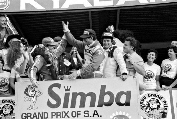 The podium (L to R): Gilles Villeneuve (CDN) Ferrari, race winner; Jody Scheckter (RSA) Ferrari, second; Jean-Pierre Jarier (FRA) Tyrrell, third.South African Grand Prix, Rd 3, Kyalami, South Africa, 3 March 1979.