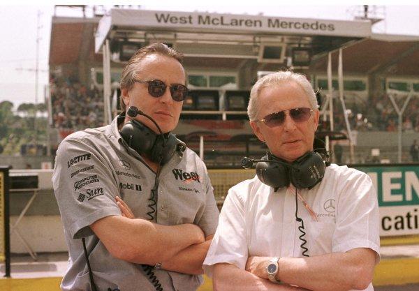 1998 San Marino Grand Prix.Imola, Italy.24-26 April 1998.(L-R) Mansour Ojjeh (TAG McLaren) and Dr Werner Hubert (Daimler-Benz) in the pitlane at Imola.World Copyright - LAT Photographic