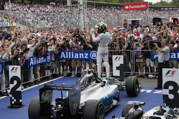 Nico Rosberg celebrates victory atop of his Mercedes F1 W05 Hybrid.