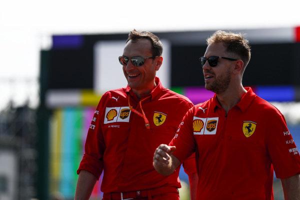 Sebastian Vettel, Ferrari walks the track with his team